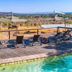 Jamila Lodge Main Pool with views of the Watering hole and Reserve