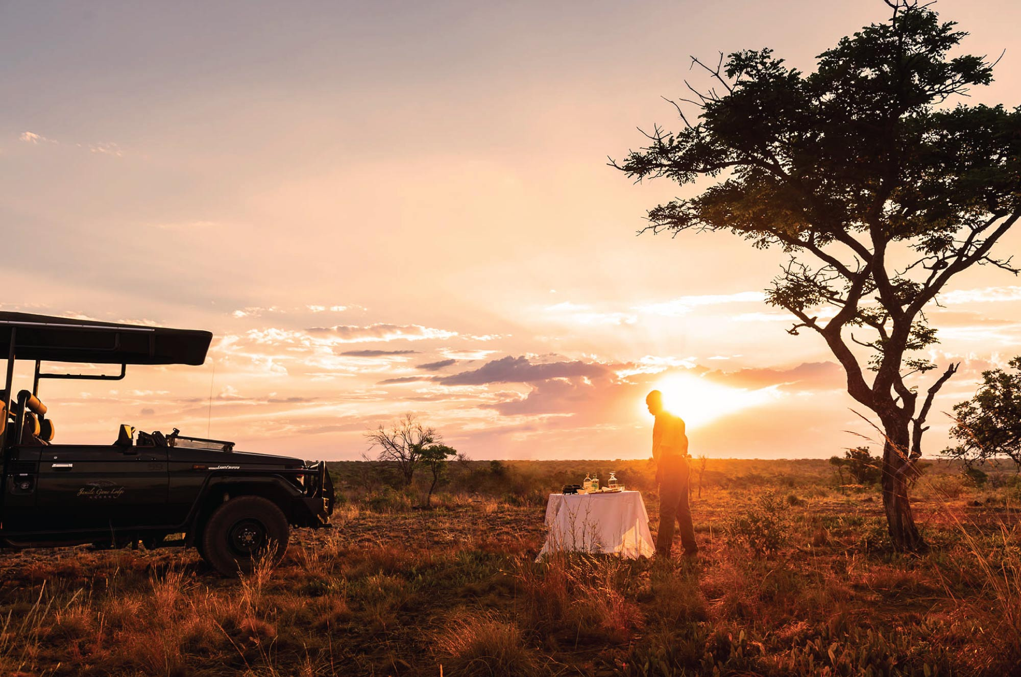 Jamila Lodge - Home Page Banner - Sunset game drive drinks