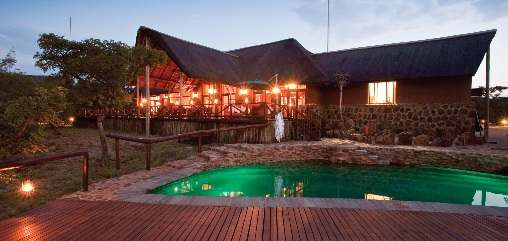 Jamila Lodge - Home Banner Pool at Night